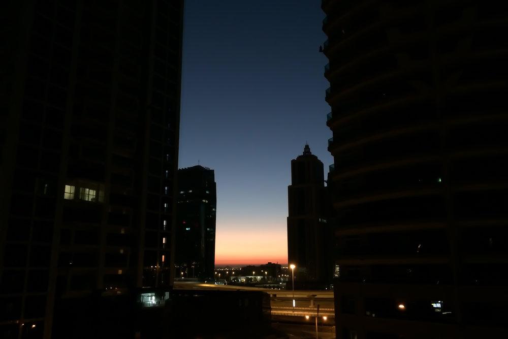 Dawn between buildings