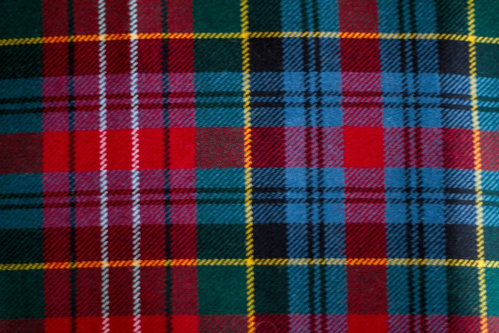 The Caledonia Tartan - The Caledonia Modern tartan is predominantly red, green, yellow, and blue. Considered a