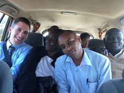Heading to the Turbo HIV Clinic, squeezed together in the back of Joe's car. I fit right in, don't you think?