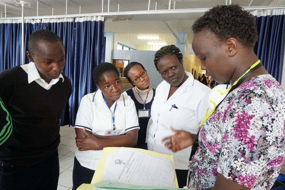 Anne Jebet with nursing trainees in the chemotherapy administration area of the Chandaria Cancer and Chronic Diseases Center.