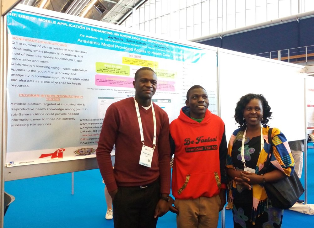 Salim Bakari (left) and Brian Kwendo (center) presenting at AIDS 2018.