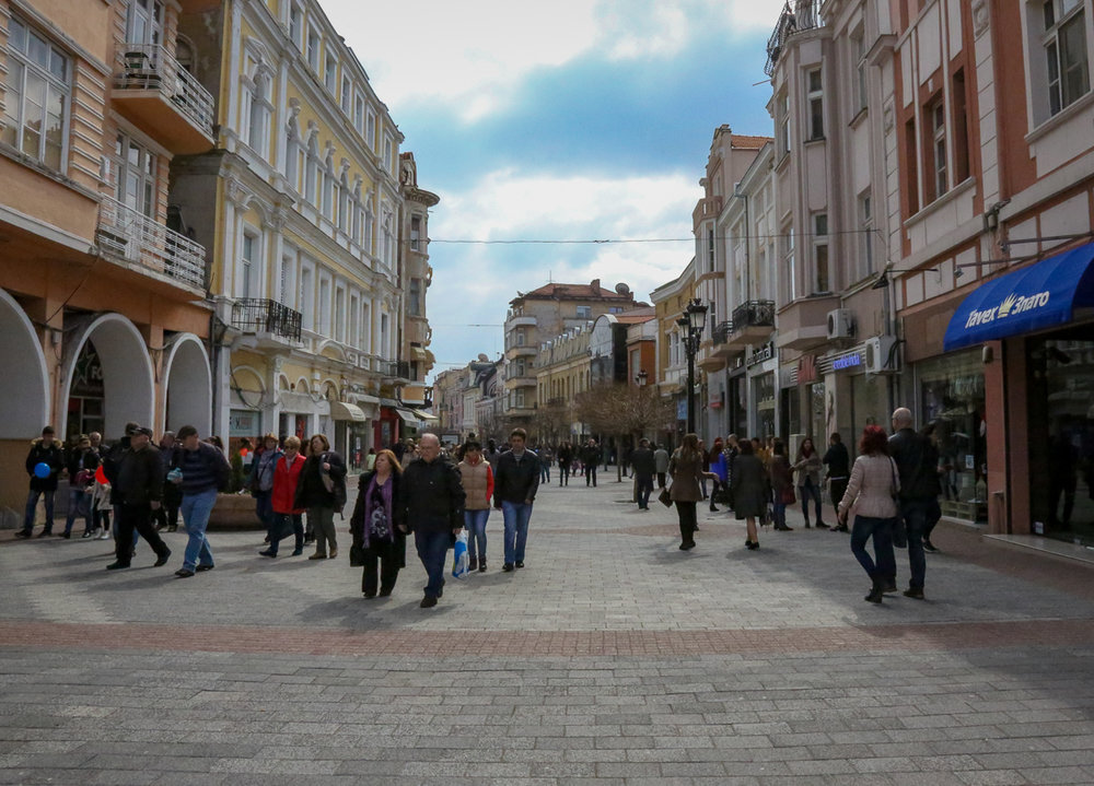 Pedestrianized street in the historic center of Plovdiv, filled with shops and restaurants.