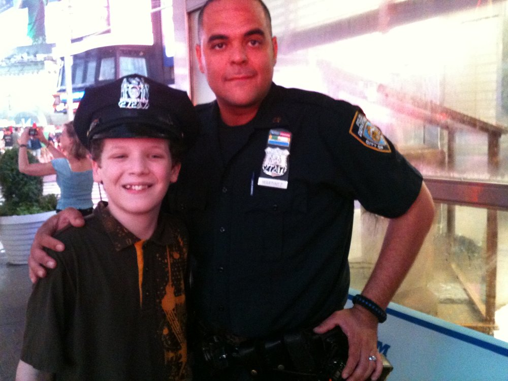Young PJ charms the hat off a NYC policeman.