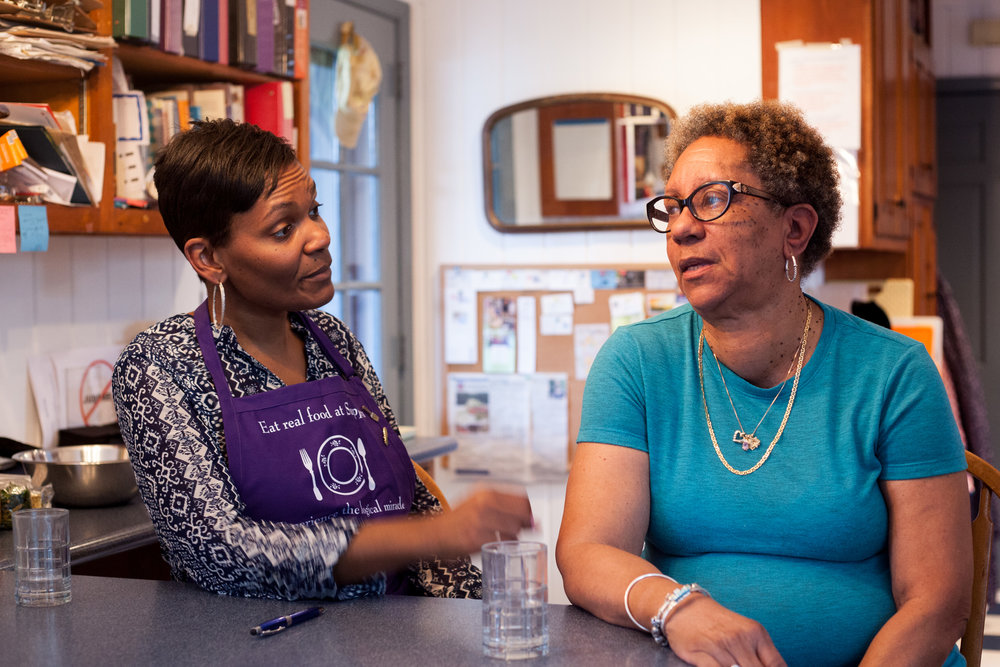 Kim Booker (left) and Barbara Jennings (right) share stories about why they started coming to Suppers and the changes they've experienced since.