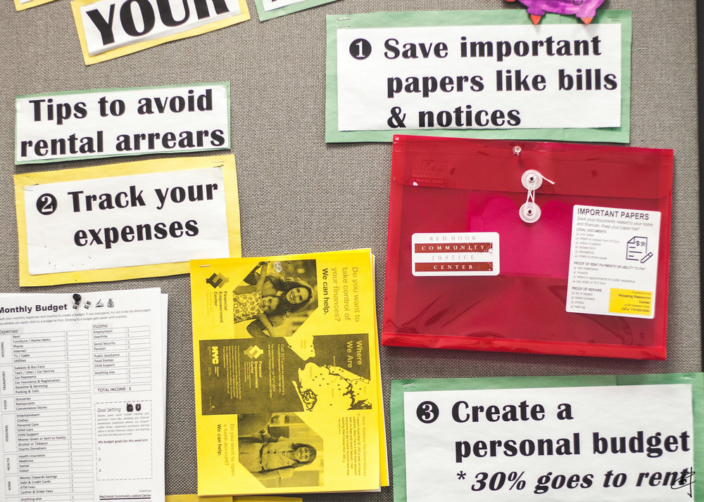 The center gives every tenant in housing court a red, translucent folder to organize their documents.