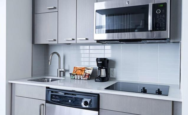 Kitchen - Fully Equipped Kitchen With A Refrigerator, Ice Maker, Microwave, Dishwasher, Stove, Small Appliances and Utensils