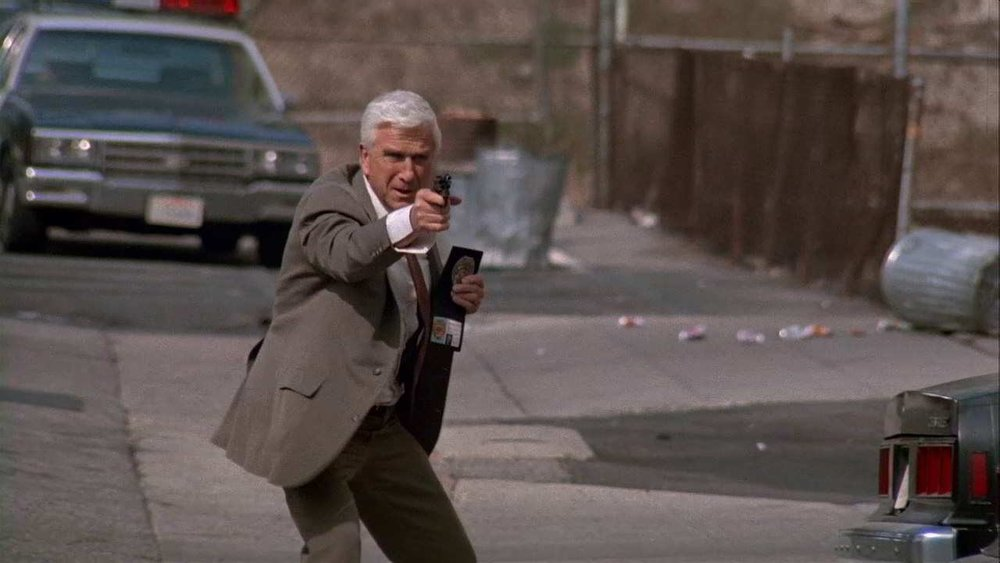 #50) The Naked Gun: From the Files of Police Squad - (1988 - dir. David Zucker)