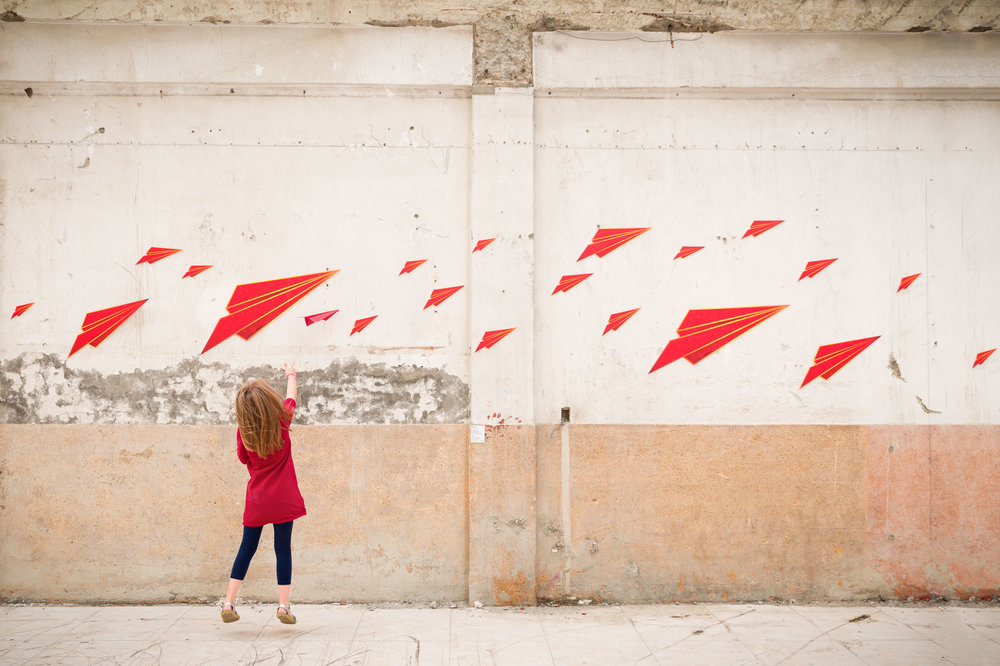 girl_in_read_throwing_a_paper_airplane_in_Personal_portfolio_by_rebecca_hunnicutt_farren.jpg