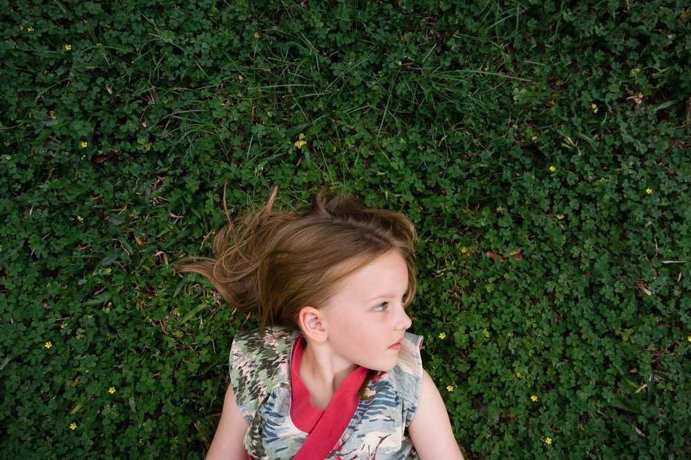 girl_laying_in_clover_Personal_portfolio_by_rebecca_hunnicutt_farren.jpg