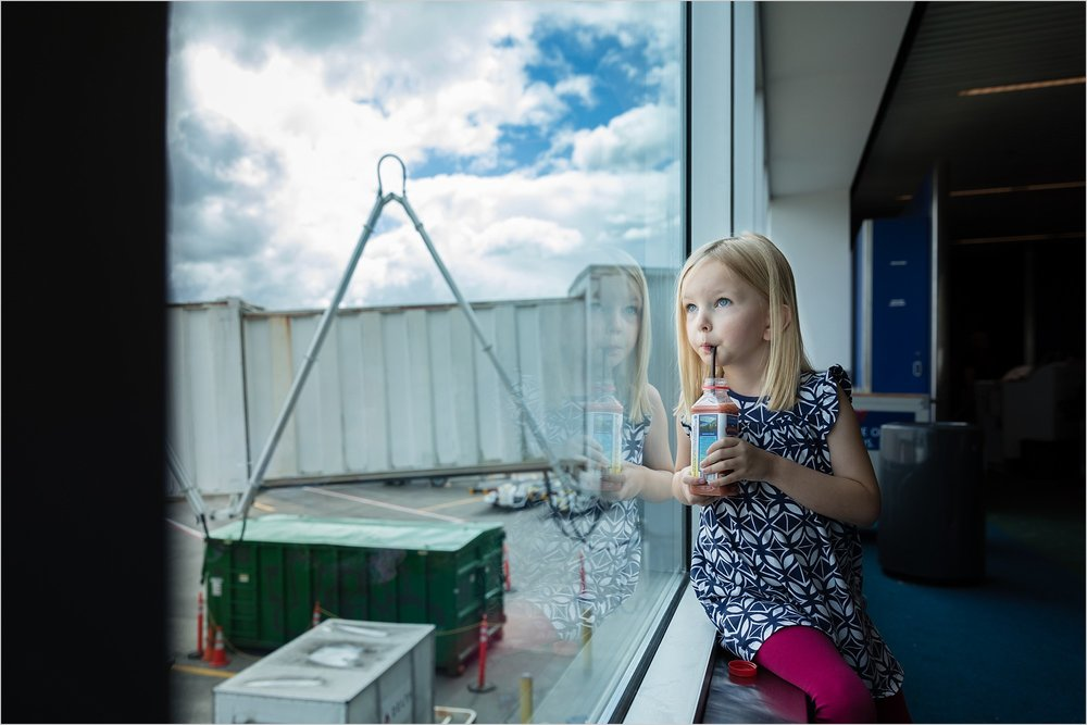 Girl_Drinking_Juice_In_Airport_Portland_Oregon_Photographer_Rebecca_Hunnicutt_Farren.jpg