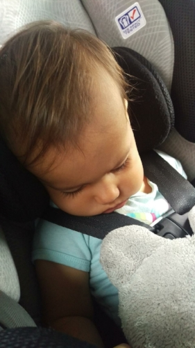 She sleeps in the car seat!