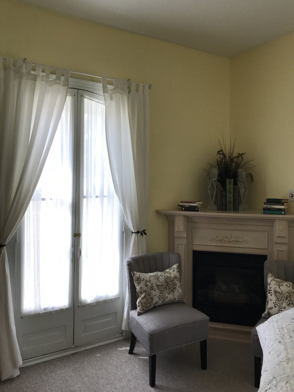 Polly Kelly - A romantic Victorian era room, with antique maple Queen sized bed, and walk-out through French doors to a private balcony. Corner gas fireplace and ensuite bathroom, with shower.