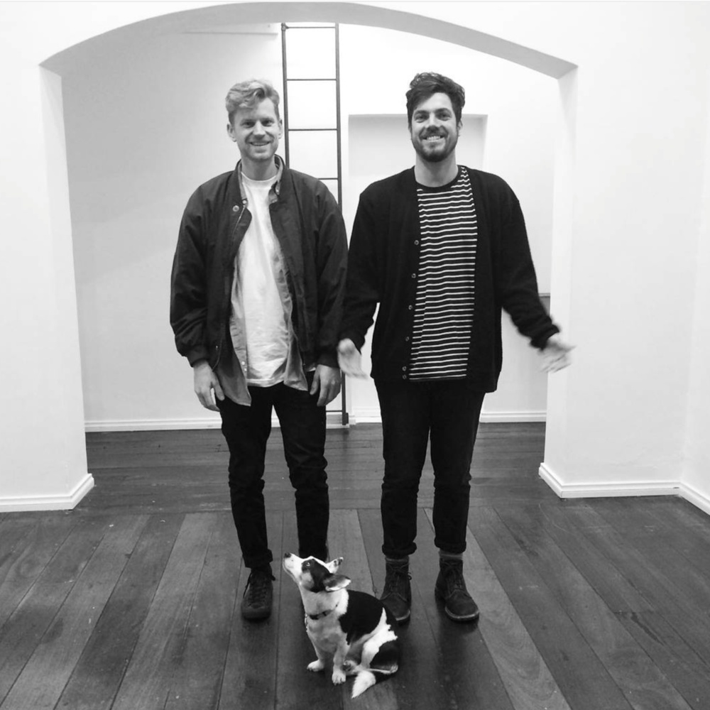Tom, Mitch and their dog standing in an empty office