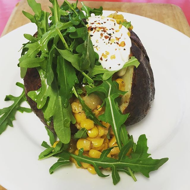 Bored for lunch? How about this to spice up your life? Olive Oil Baked Potato w/ Smoked Creamed Corn, Yogurt, Rocket and Chilli. Daaaaaamn fine #yummy #lunch #supportlocal #spud #spiceupyourlife #sweetcorn #friday