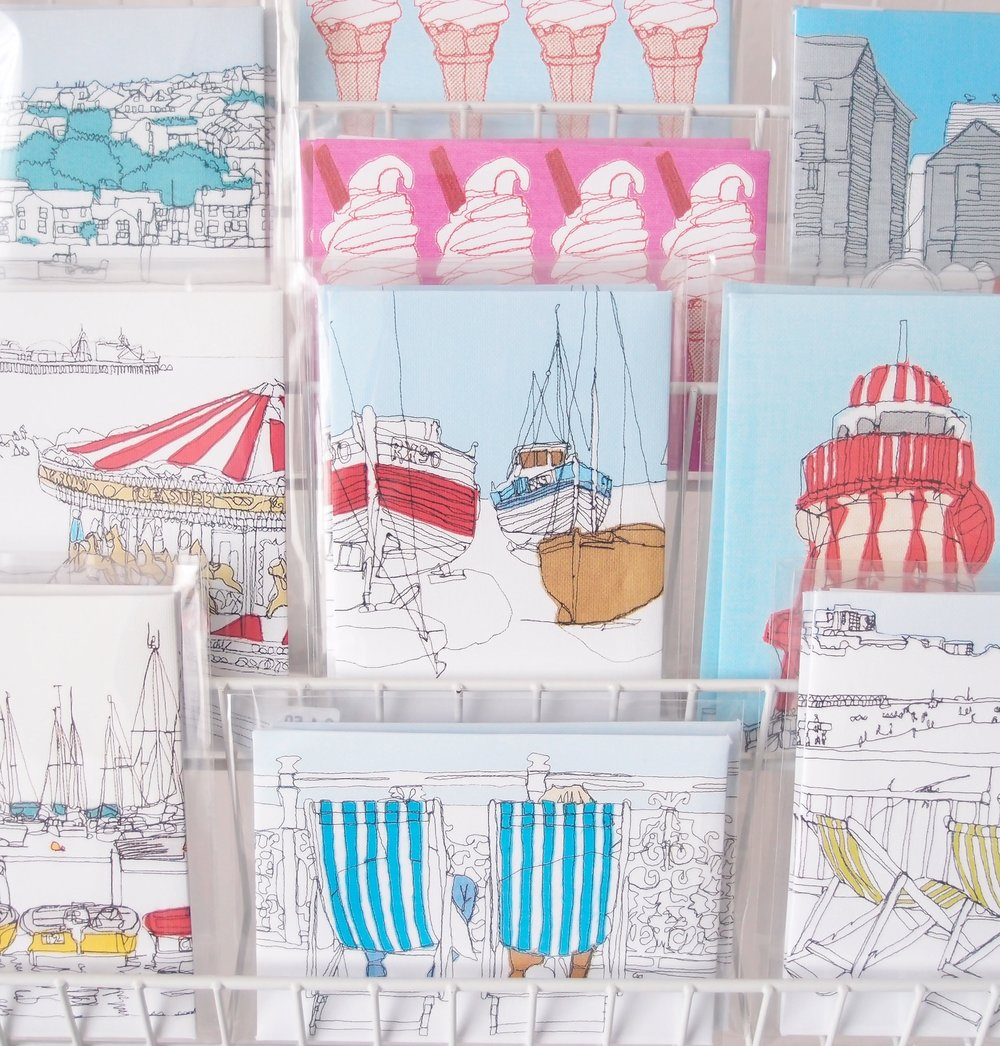 Bundles of brightly coloured postcards to choose from.