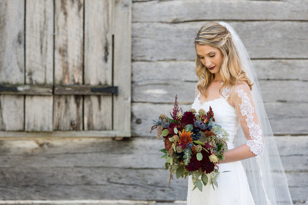 Stunning Bridal Shot with Flowers in Front of Barn  |  Bride on Wedding Day  |  Life & Art Photography  |  Destination Wedding Photographer