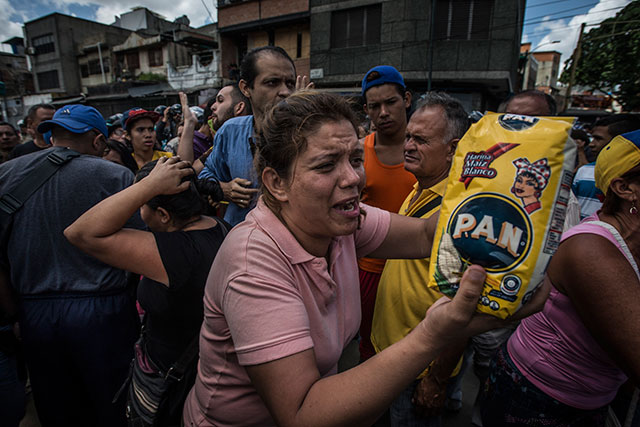 Chaos as citizens of Venezuela line up for food rations because their currency no longer holds value.