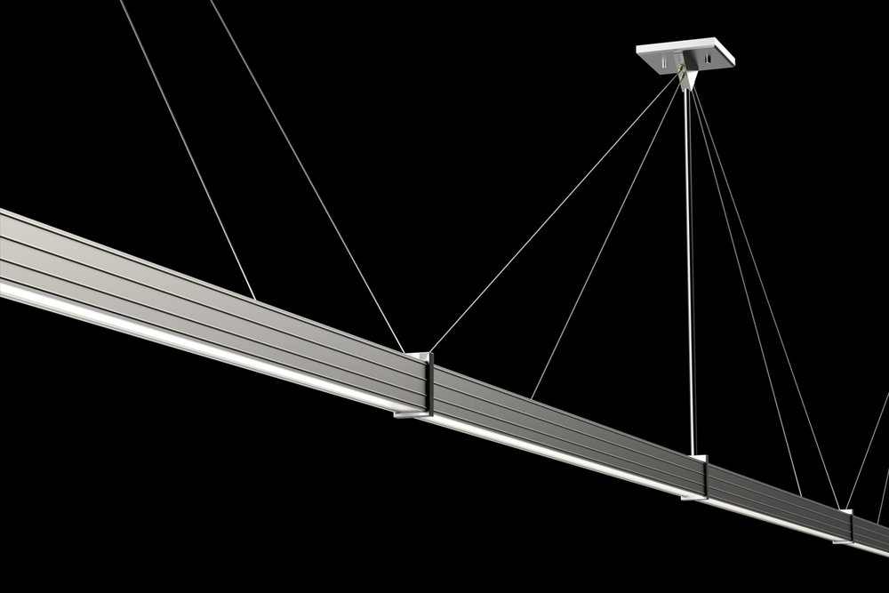 NIKOLA® SYSTEMS - Linear system continuous runs are center fed every 8' to give even power distribution for consistent light output end to end, no shadows. Single point suspension for an 8ft unit allows for less ceiling disruption.