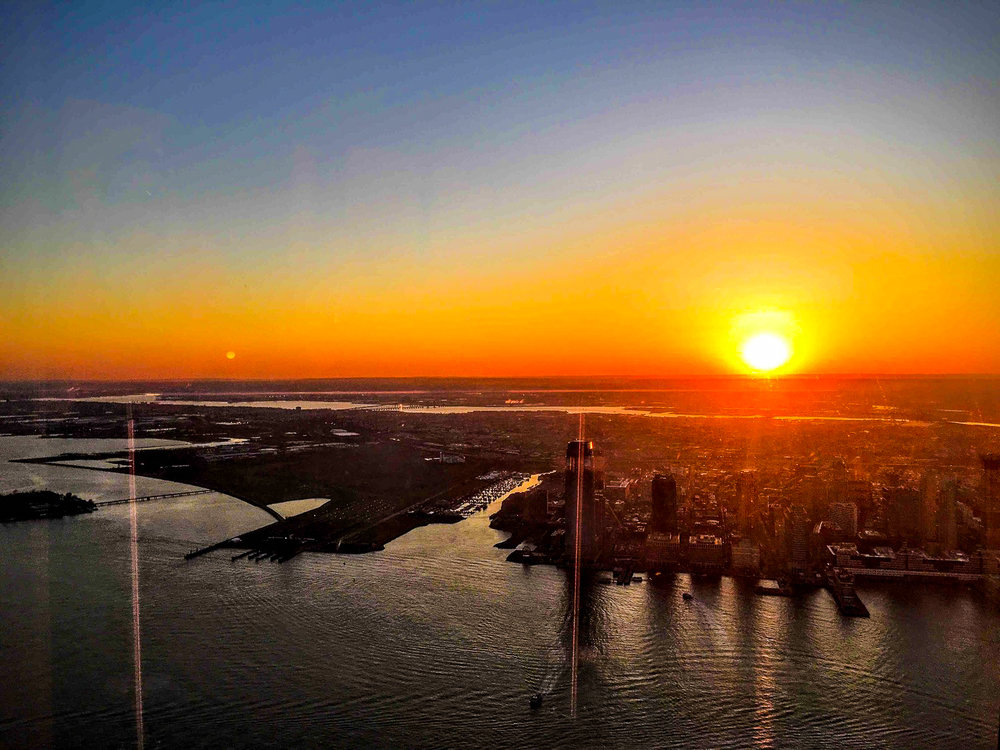 SUNSET FROM THE 102ND FLOOR OF THE ONE WTC. PHOTO:  FILMVACATION