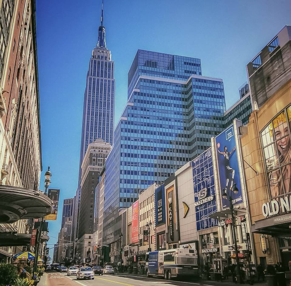 The empire state building, captured from 34th street, in front of macy's store. photo:   @lucascompan
