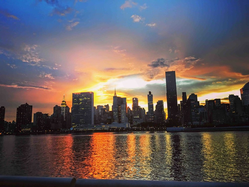 The United Nations building witnessing a beautiful, peaceful sunset. from Long Island City. Photo: Lucas Compan