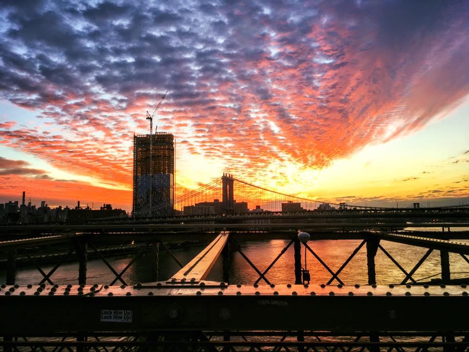 AN EPIC SUNRISE FROM THE BROOKLYN BRIDGE. PHOTO: LUCAS COMPAN