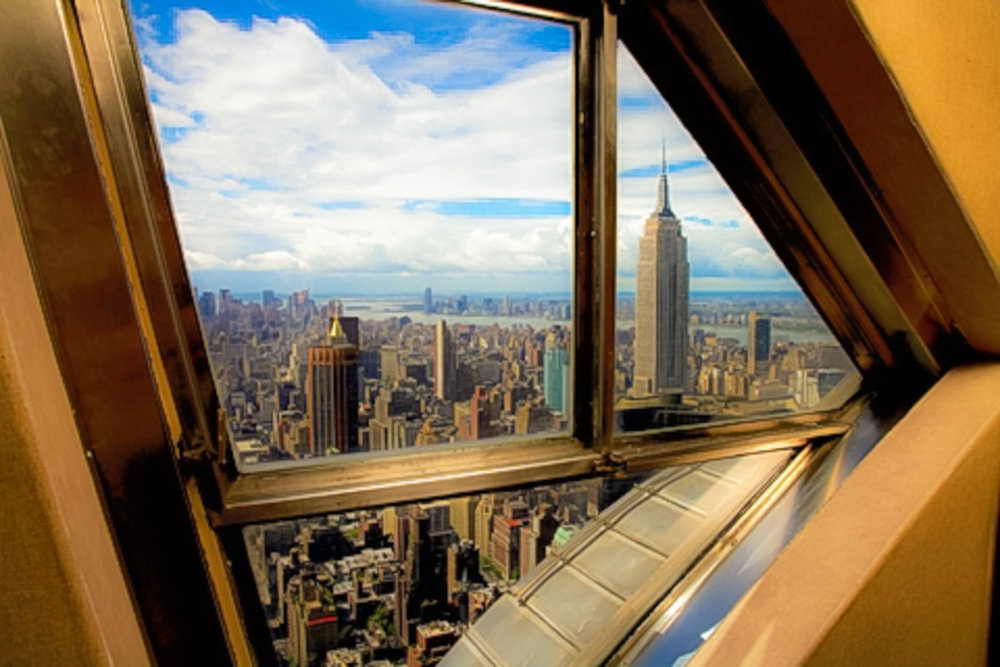 the empire state building seen from a windon in the spire of the chrysler building