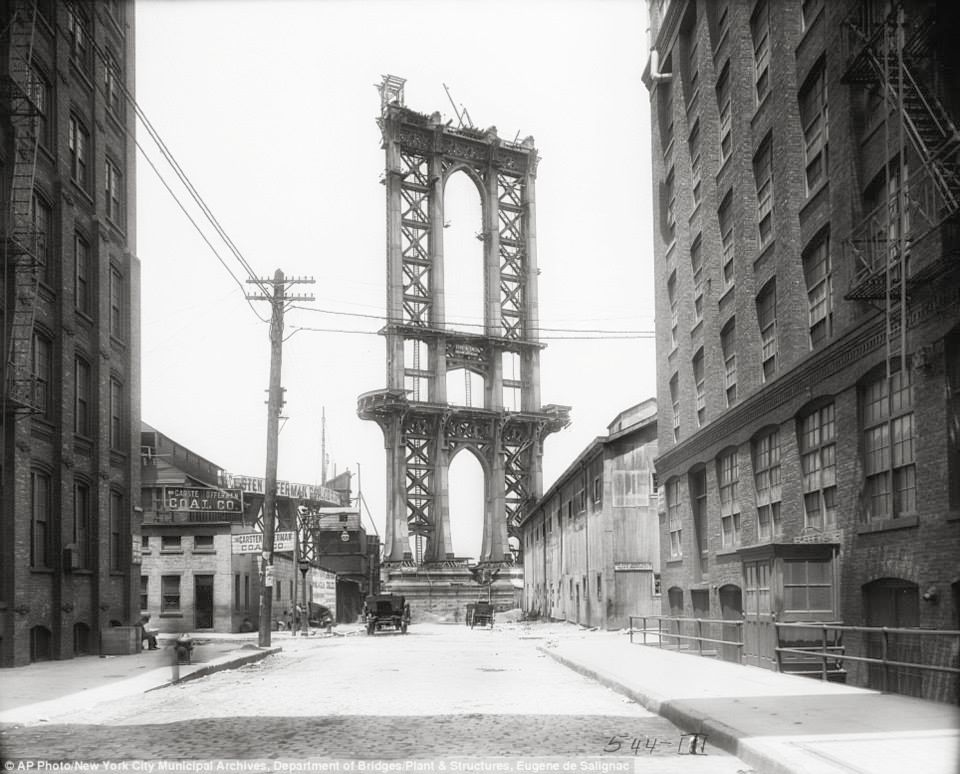 Washington Street in    DUMBO   , Brooklyn (1908) and the construction of the Manhattan Bridge. The bridge was officially opened to traffic on Dec. 31, 1909.  | Image: New York City, Department of Records
