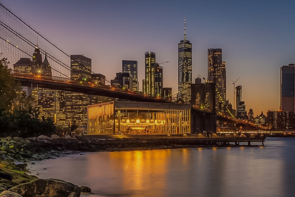 jane's carousel, the brooklyn bridge, and the freedom tower in lower manhattan. photo: lucas compan