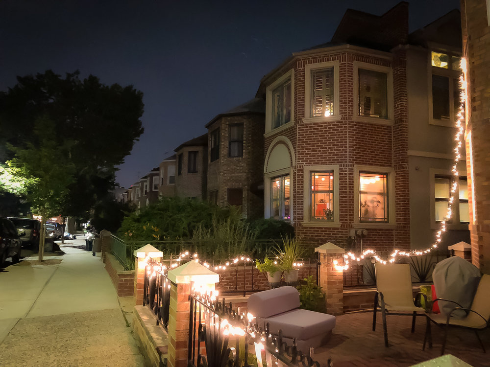 when it's summertime, Families and couples enjoy dinner out in their front yards.