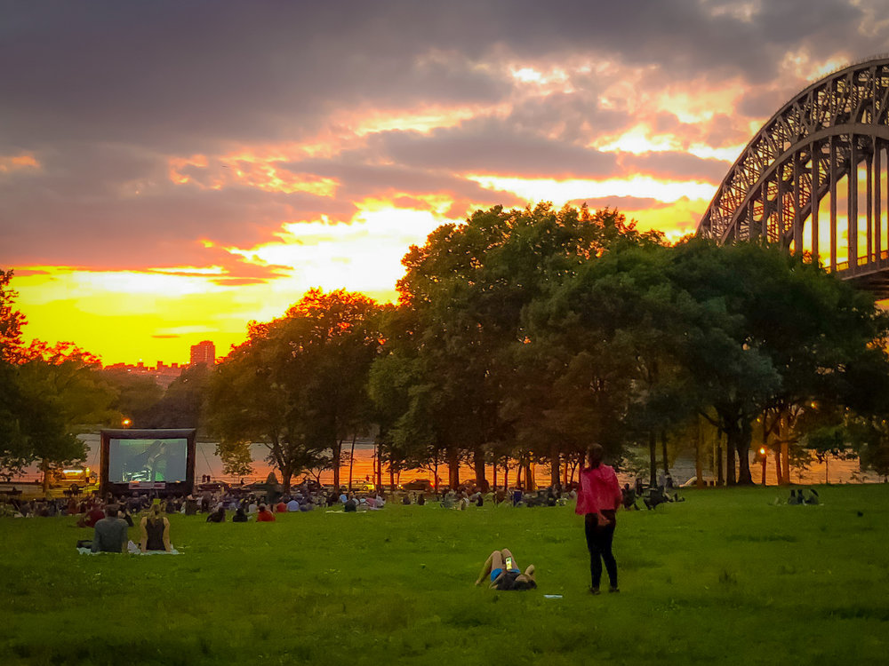 How about watching a movie on an outdoor screen with a scenic view?