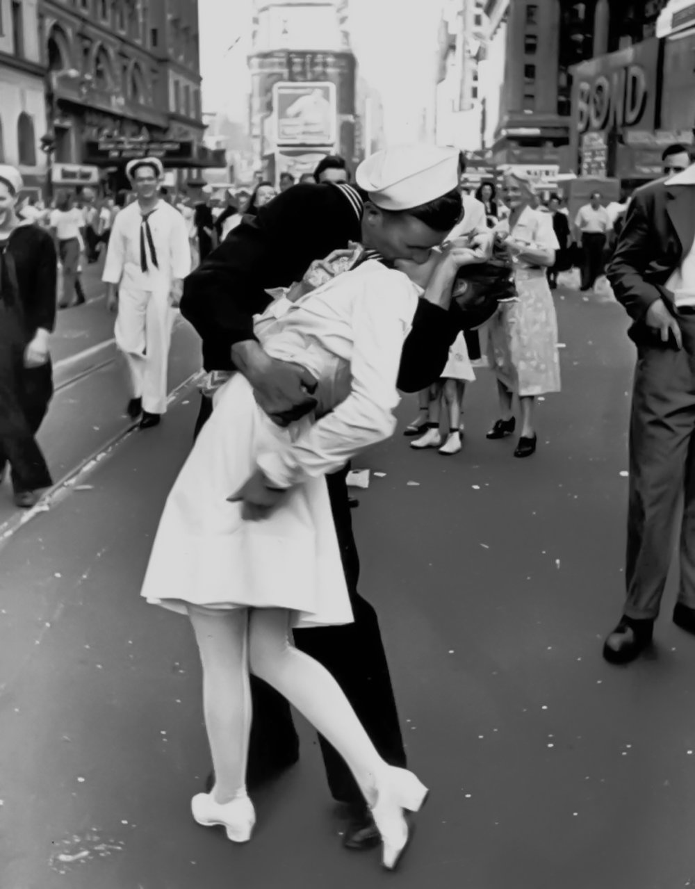 A sailor sweeps a nurse off her feet with a kiss in New York's Times Square in this famous photograph taken by Alfred Eisenstaedt on the day Japan surrendered to end World War II. (AP Photo/copyright-Alfred Eisenstaedt/Life Magazine)