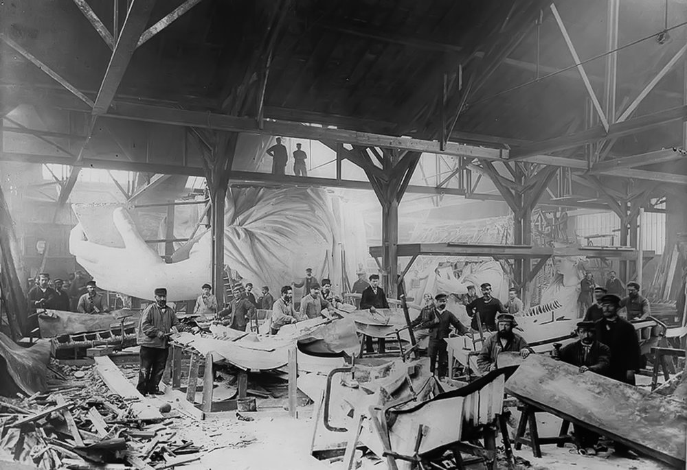 Workmen constructing the Statue of Liberty in Bartholdi's Parisian warehouse workshop; first model; left hand; and quarter-size head–Winter 1882. (Photo by Albert Fernique (1841-1898) / Library of Congress)