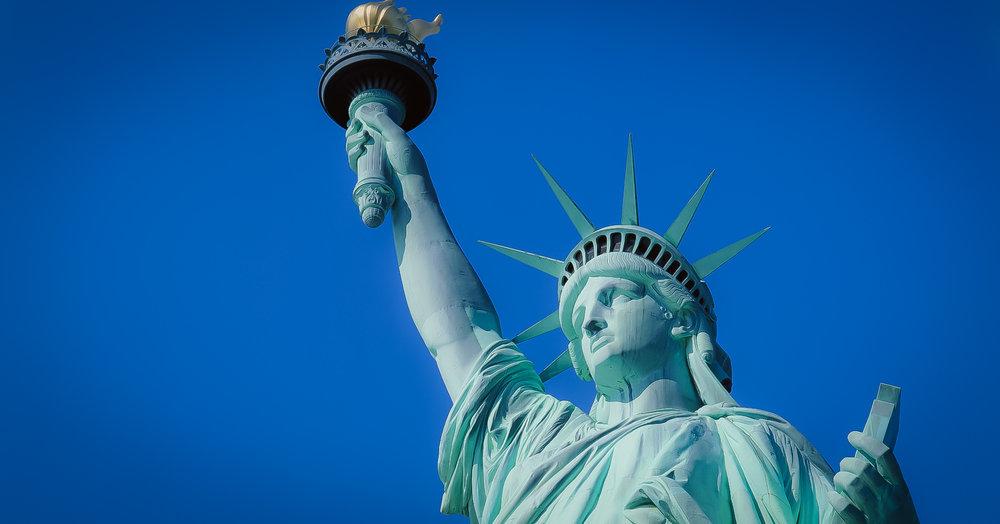 Lady Liberty surrounded by blue sky. Photo: Daniel Mirkov