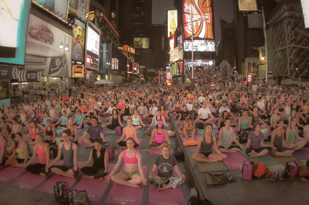 Yoga at night in times square. photo: google