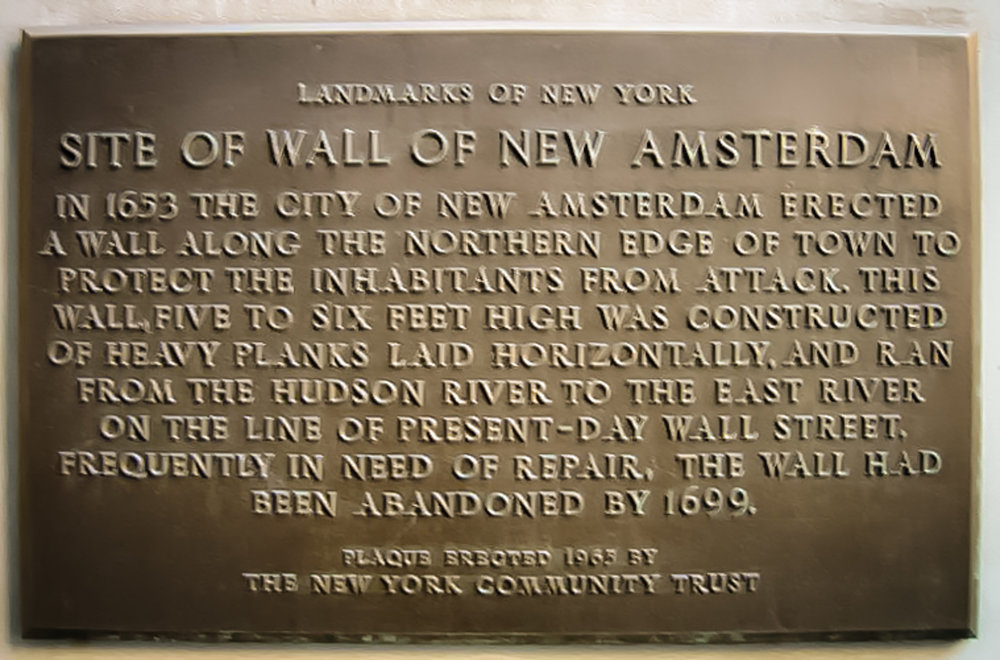 A plaque honoring the old wall sits today at the corner of Wall and Broadway, where the gate to the city once opened. Photo: Lucas Compan