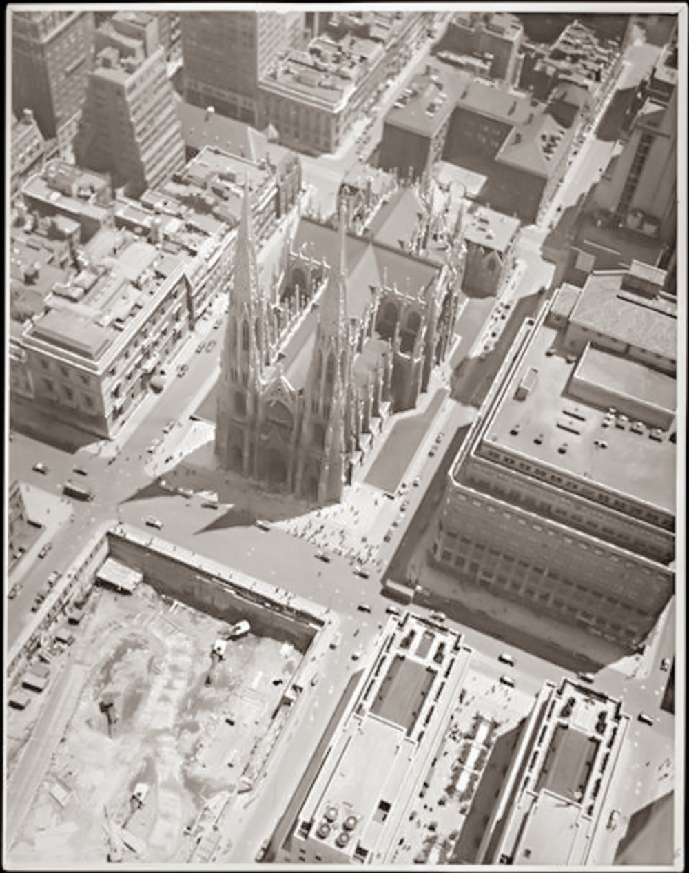 Aerial view of St. Patrick's Cathedral and International Building (Rockefeller Plaza) under construction. (Image: John Albok / 1894-1982)
