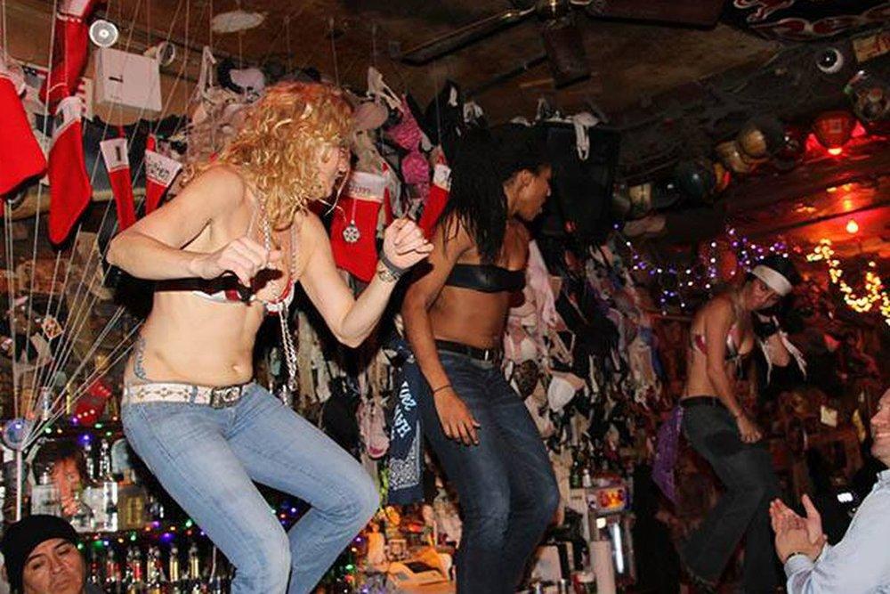 bartenders dancing at the bar. Photo: lucas compan (2011)
