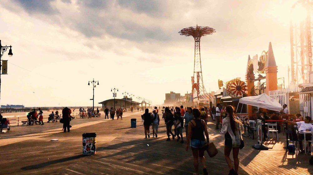 Coney Island, where people dive into a relaxation and entertainment atmosphere each summer. in this photo, the boardwalk. photo    @lucascompan