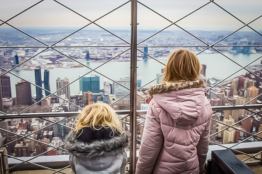 kids having fun enjoying the view from the empire state observatory. image: google