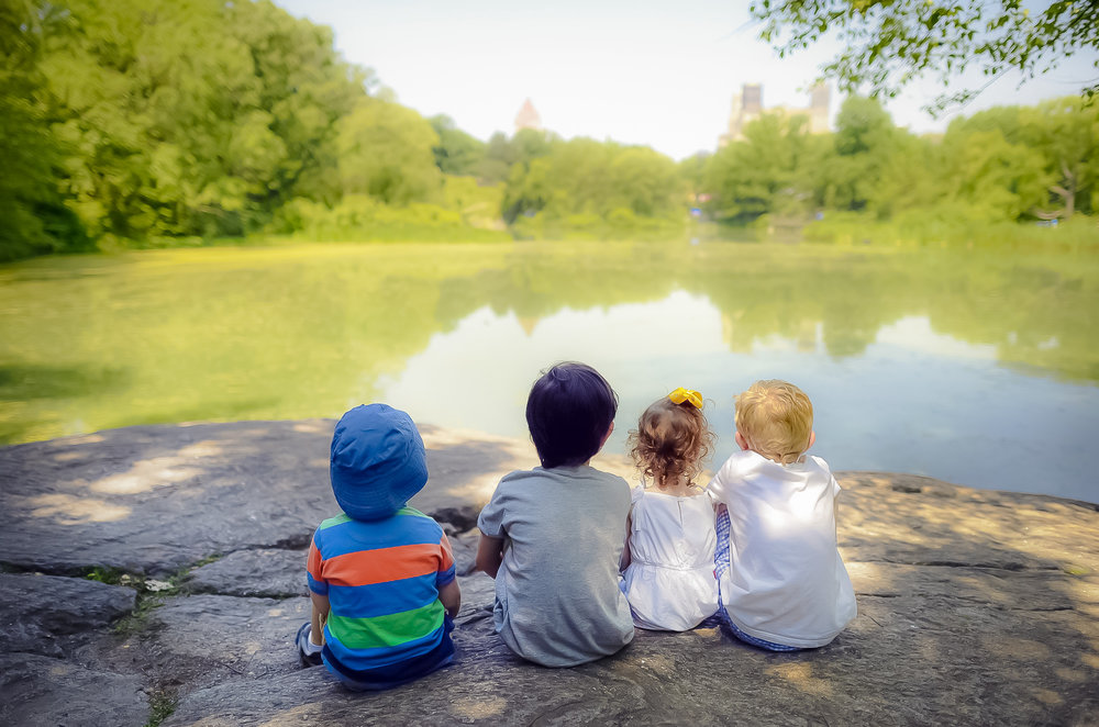 kids relaxing in central park. photo: google