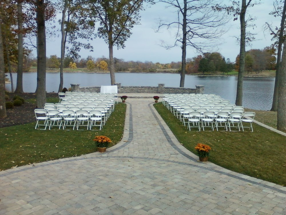 white sam.chairs ceremony set-up.jpg