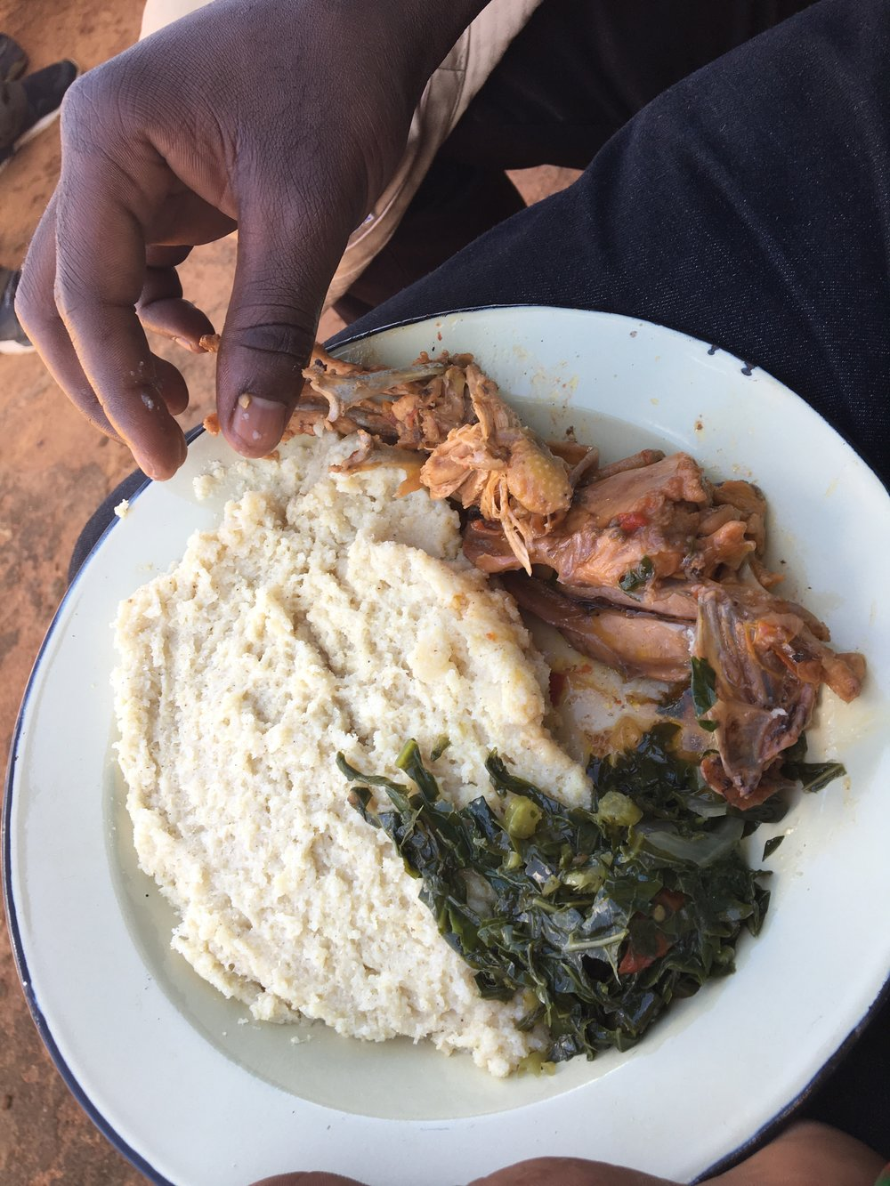 Everyone got a full plate of lunch: sadza, sauteed rape (canola) greens, and chicken, of course!