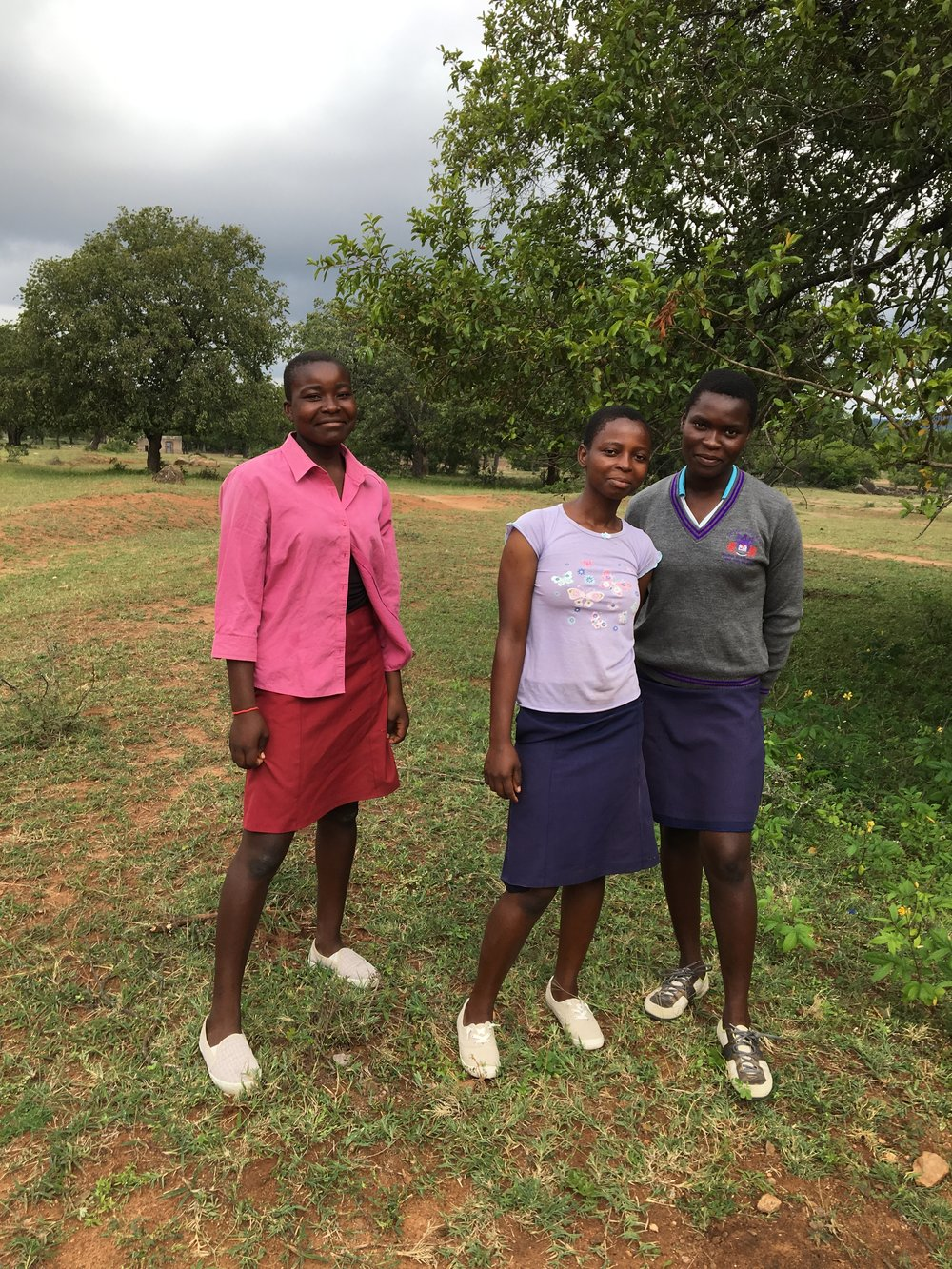 New shoes for Precious, Yvonne, and Tatenda