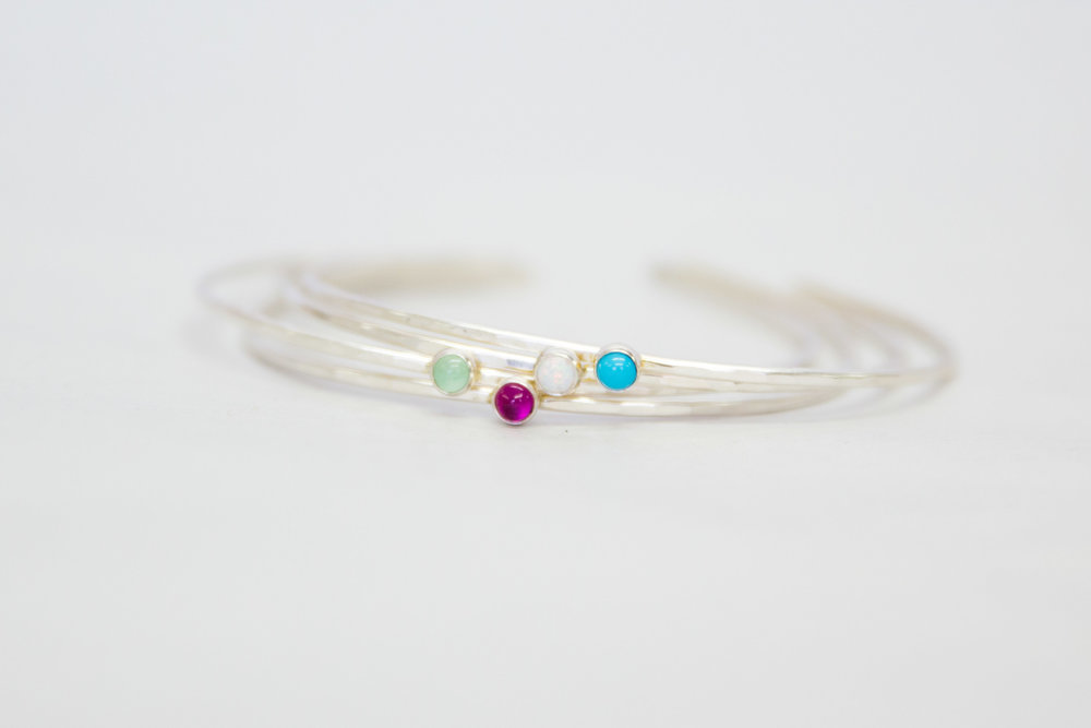 Silver stone stacking bangles $48
