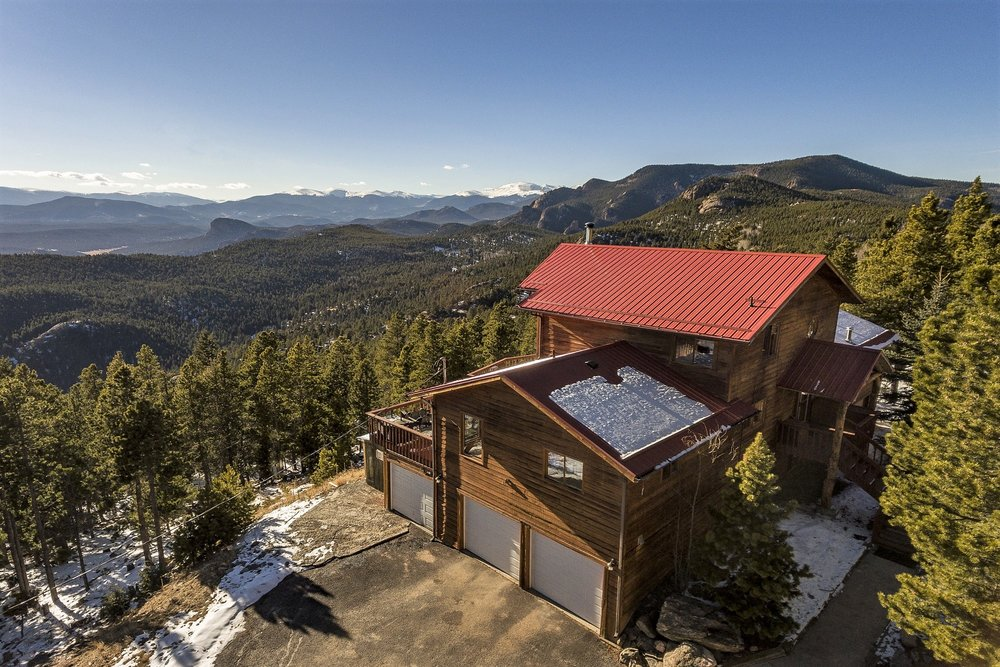 This was our hold home for over 20 years. It sat on the side of a mountain, almost at the top of it, so it boasted an expansive view.