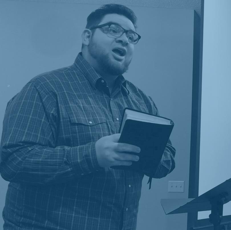 Blue dean preaching.png