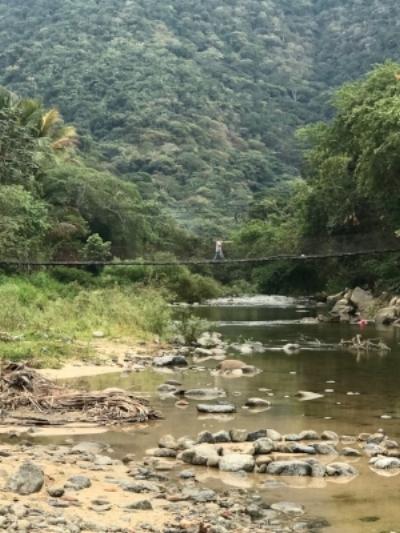 The narrow, creaky, and swinging bridge to our Casa