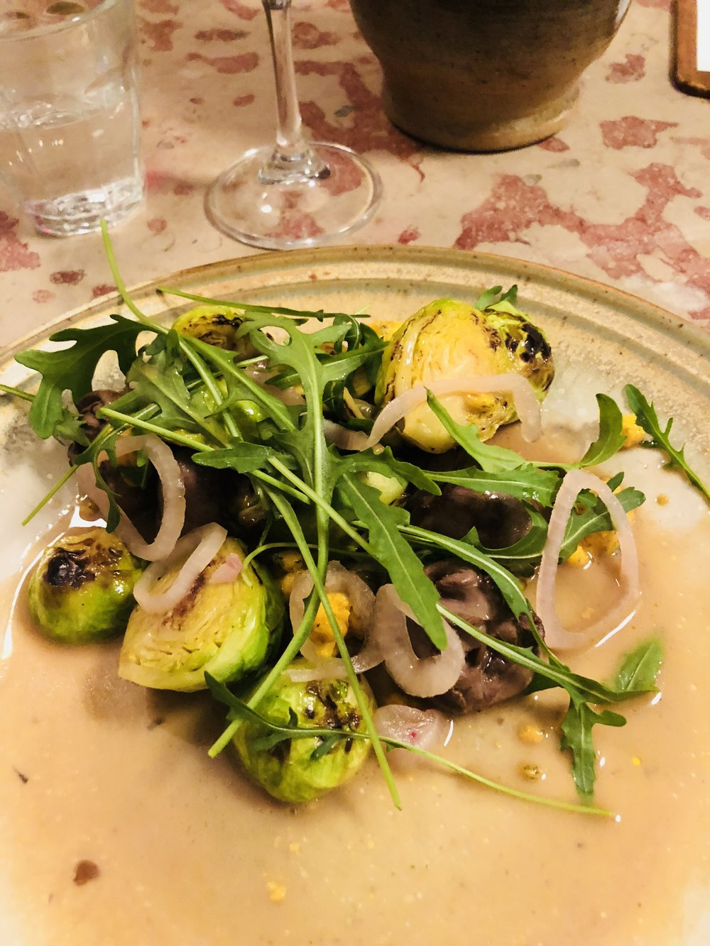 Sauteed Duck Hearts with Pan Roasted Brussels Sprouts, Pickled Onion, and Micro Greens
