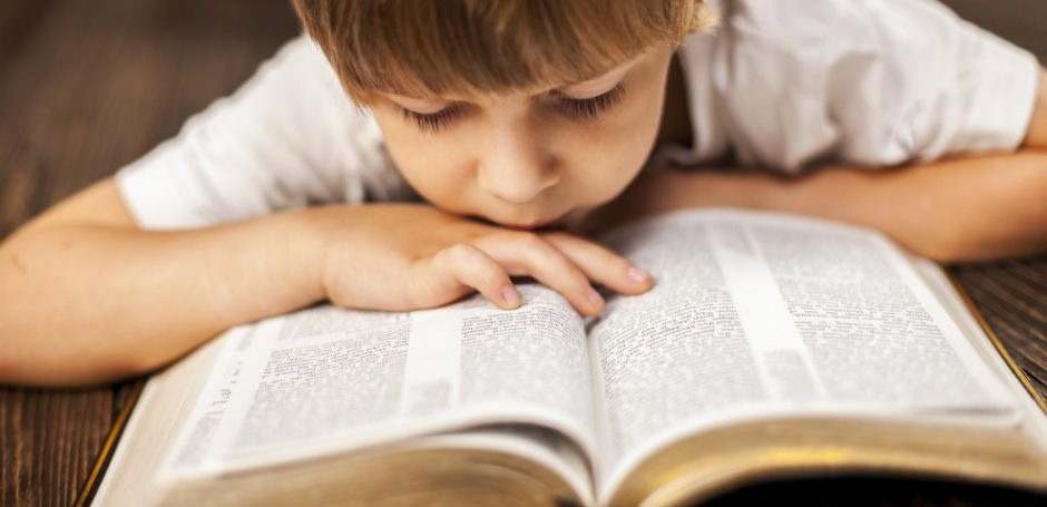 Boy-reading-the-Bible-940x455.jpg